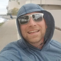 Picture of AJ Stop the Dad Bod Crushing it with a smile during his run