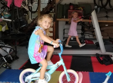 Two daughters working out in dads pain cave