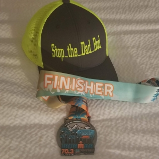 Stop the Dad Bod Trucker Hat with Ironman 70.3 Indian Wells LaQuinta Finisher Medal
