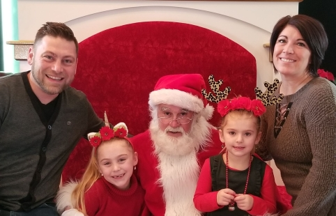 Happy Family sitting with Santa 2019